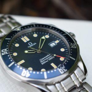 blue dial, wave dial, quartz, omega