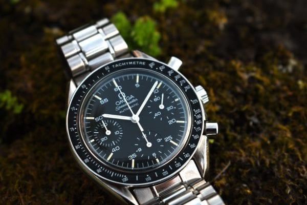 black dial, chronograph, omega, omega speedmaster