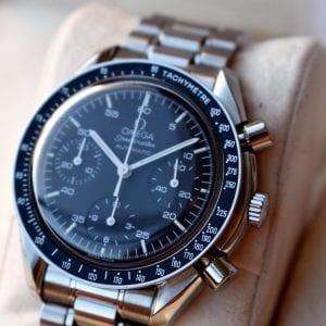 black dial, omega speedmaster, omega reduced