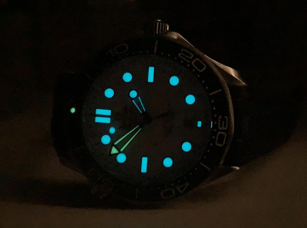 The two-color lume is well executed with a green minute hand and bezel marker on blue lume indices